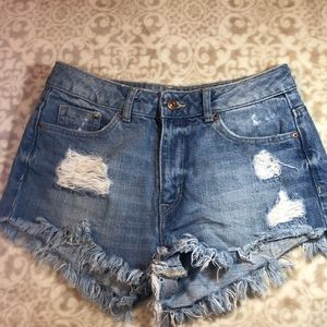 Blue jean high waisted distressed shorts.